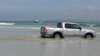 Car parking in St Ives is free on the outer harbour sands - but not when you misjudge the tide. Rob and Peter supervise the ...
