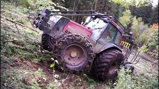 Video Valtra forestry tractor logging on steep slopes, slippery uphill, difficult conditions MP3, 3GP, MP4, WEBM, AVI, FLV November 2017
