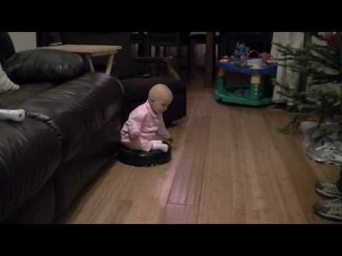 Baby Riding on a Roomba