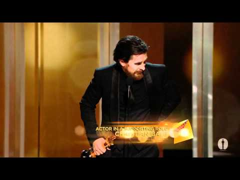 Christian Bale - Reese Witherspoon presenting Christian Bale with the Oscar® for Best Supporting Actor for his performance in