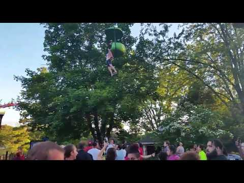 Woman falls from Six Flags Great Escape ride; crowd gathers to catch her.