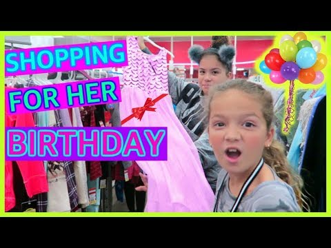 SHOPPING FOR OUR COUSIN BIRTHDAY , EACH ONE BUYS AN OUTFITS \
