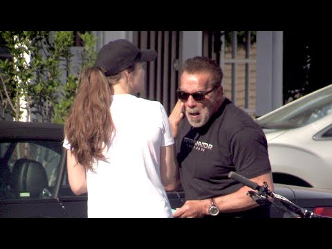 Arnold Schwarzenegger And Daughter Christina Lather Up With Sunscreen Before Their Bike Ride