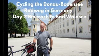 Day 2 of my bicycle tour along the Donau-Bodensee Radweg in Germany. This video covers the section of cycling between Biberach and Bad Waldsee. Along the way, I had a ride on a steam train, ate in a Scottish influenced cafe, and took a stroll around a monastery. You can find out more about Ochenhausen monastery by following this link - http://www.kloster-ochsenhausen.de/en/home/