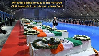 PM Modi paying homage to the martyred CRPF Jawans, at Palam airport, in New Delhi