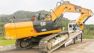Cool!! BIG Digger CAT 336D2 Excavator Moved Down The Hill By Quester Self Loader Truck.CAT 336D2 Digger Excavator being transported by Quester Self Loader Truck. Quester CGE 370 Triton Self Loader Truck. Related Videos :Excavator Accident Kobelco SK200 Fuso Self Loader Truck Heavy Recovery   https://www.youtube.com/watch?v=ICOPK--lg-8Excavator Stuck Kobelco SK200 End of Recovery   https://www.youtube.com/watch?v=kY7hj792ft8Stuck Concrete Mixer Truck Heavy Recovery   https://www.youtube.com/watch?v=LK6PLnzFc98Mini Excavator Stuck Heavy Recovery Komatsu PC75UU  https://www.youtube.com/watch?v=3S9_7v59Bw0Excavator Stuck In Mud Kobelco SK200 Heavy Recovery Extended   https://www.youtube.com/watch?v=xy0NJr6WiyMMini Excavator Heavy Recovery Kobelco SK200   https://www.youtube.com/watch?v=OQuK_zIVmOQExcavator And Dozer Working On Road Costruction Site   https://www.youtube.com/watch?v=y_teBRYkIr8Dump Truck Delivering And Unloading Dirt At Road Construction Site   https://www.youtube.com/watch?v=5NC7iOSlMaAAsphalt Eater Machine Working SAKAI ER501F Cold Milling   https://www.youtube.com/watch?v=X4scDsUywJUDump Truck Stuck Recovery By Komatsu D85E-SS Dozer   https://www.youtube.com/watch?v=uPIPBXwf5GgQuester Self Loader Truck Moving Tire Roller   https://www.youtube.com/watch?v=tP441urn90YLarge Excavator Working On Road Construction   https://www.youtube.com/watch?v=giFm4XtCRVwSelf Loader Truck Unloading Komatsu D85E-SS Bulldozer Working   https://www.youtube.com/watch?v=wfHW7zWqSAkEpic Dump Truck Stuck Off Road Recovery Part 2   https://www.youtube.com/watch?v=RbXXcZx1khEEpic Dump Truck Stuck Off Road Recovery Part 1   https://www.youtube.com/watch?v=VUbycrsciNwEpic Dump Truck Off Road   https://www.youtube.com/watch?v=YmGKGqh5mS0Large Excavator Work CAT 336D LME Swingging Dirt   https://www.youtube.com/watch?v=CW_UgsKmPzsBulldozer CAT D6R Hard Working On Road Construction   https://www.youtube.com/watch?v=EVs8ocV2-AEFB : http://www.facebook.com/MrZygy3Twitter : http://twit