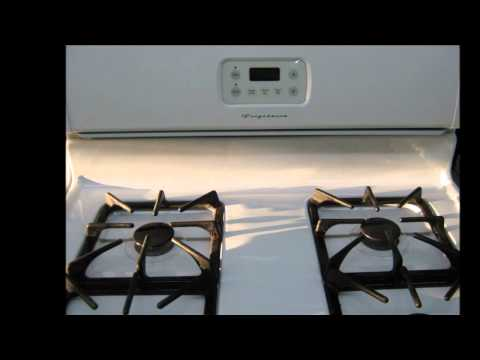 Used Frigidaire gas stove, white, 4 burner, works well