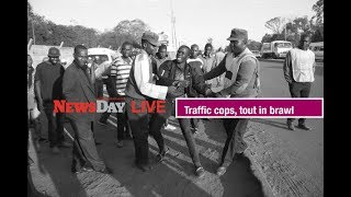 Zimbabwe traffic police, tout in brawl.