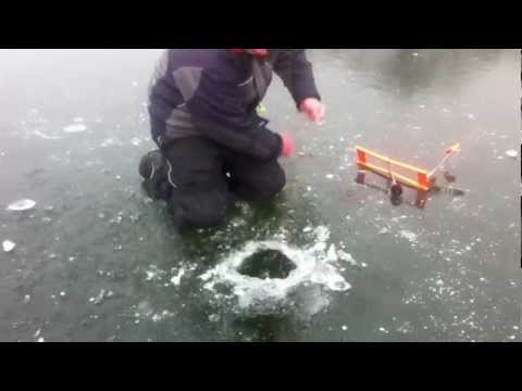 Giant Bass Caught Through The Ice!! Tip Ups Nov. 2012