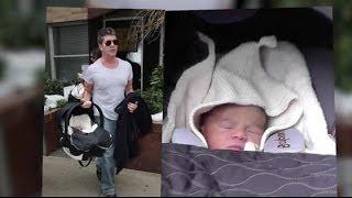 Simon Cowell Has A Little Trouble Loading Son's Car Seat   Splash News TV   Splash News TV