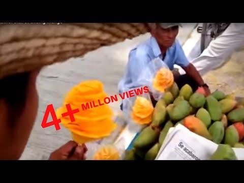 guardate come taglia il mango questo venditore ambulante!