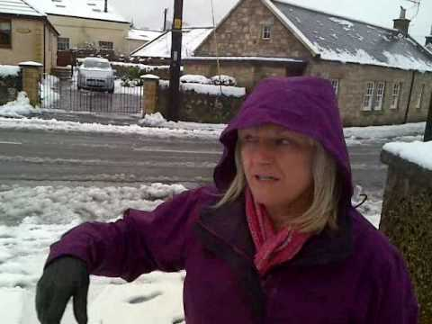 "Guys mom reacts to the snow ""man"" he built in their yard"