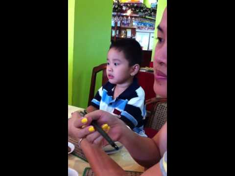 Cambodian kid having Chinese Noodle Soup