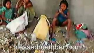 Poor Children Eating From Garbage
