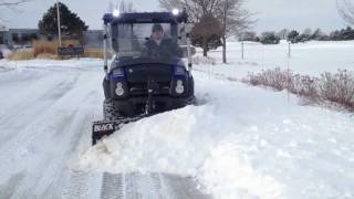 7. Kawasaki Mule 610 XC Plowing Snow - Blackline Plow