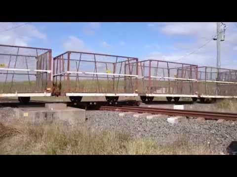 Train Crossing The Queensland Rail Main Line Near Bundaberg