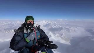 Scott Mackenzie stands on the Summit of Everest by teamBMC