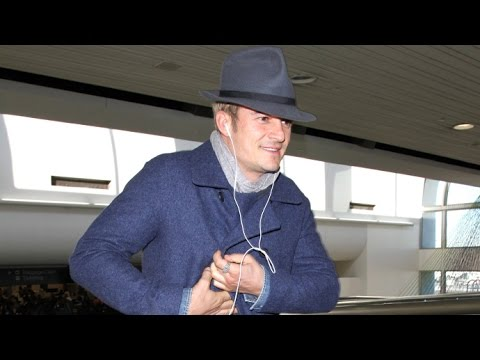 Orlando Bloom Flashes A Smile When Asked If He's Proposed To Katy Perry