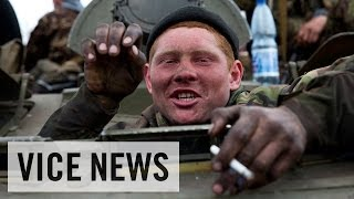 Ukrainian Military Give Up Their Weapons