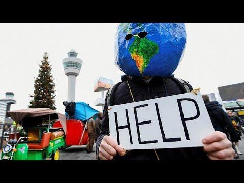 Ολλανδία: Διαδήλωση υπέρ του κλίματος και κατά του αεροδρομίου Σίπχολ…