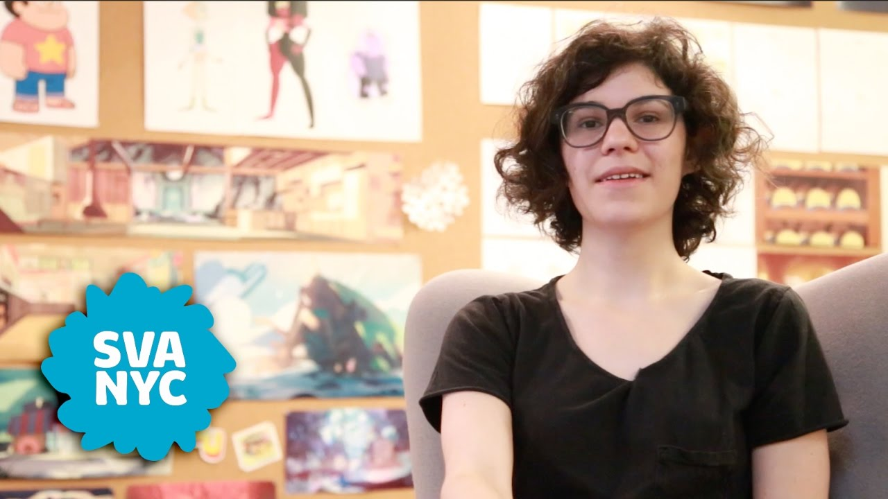 Rebecca Sugar sitting at her desk with sketchs for Steven Universe behind her