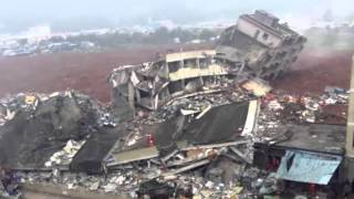 """massive landslide buried an industrial park in the southern Chinese city Shenzhen on Sunday morning, according to Chinese state media reports and online posts. The number of casualties is  unknown. At least 27 people remain missing, and rescuers have pulled four people alive from collapsed or buried buildings, China's state newswire Xinhua reported on Sunday afternoon. About 1,500 rescue workers have been dispatched to the scene.The landslide occurred at 11:40 a.m. and covered an area of more than 215,000 square feet in Shenzhen's Guangming New District, including the Liuxi Industrial Park, according to a televised statement by Shenzhen municipal official Li Yikang. At least 900 people have been evacuated, he said.After the landslide, China's president Xi Jinping issued an """"important directive"""" demanding that provincial and municipal authorities """"rapidly organize"""" emergency response measures and """"do their utmost to ensure that casualties are minimized.""""Several people have been trapped, and the number of casualties cannot be estimated,"""" said an article on the website of the state-run People's Daily.Subscribe https://www.youtube.com/worldnews1https://www.youtube.com/channel/UCC9R3qjRAXMa9w4k_SzmKTAwatch https://youtu.be/UAb4HLOELwIChina landslide: 22 buildings collapse in Shenzhen industrial parkBBC News - 4 hours agoSome 22 buildings have collapsed in a landslide at an industrial park in the southern Chinese city of Shenzhen. About 900 people have been evacuated, with four people pulled alive from rubble with minor or no injuries, the local government said.China Landslide Buries BuildingsWall Street Journal - 3 hours ago... a landslide in Shenzhen, in south China's Guangdong province, Sunday. The ... Rescuers spray liquid next to damaged sheds at the site of a landslide at an industrial park in Shenzhen. Reuters … Rescuers search for survivors at the site of the ...Landslide in Shenzhen, China Destroys Buildings and Leaves More Than 20 ...The Weather Channel - 2 hour"""