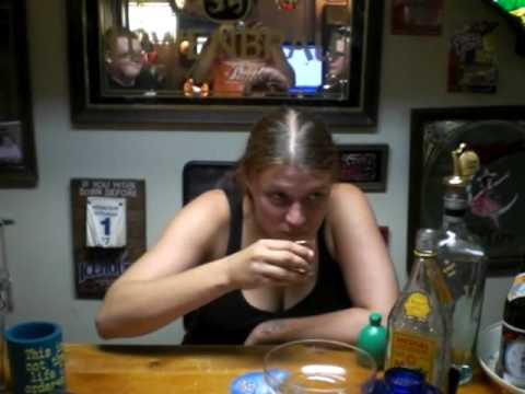 Girl eats mezcal worm in greatest home bar ever