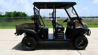 "9. $14,999 Fully Accessorized 2013 Kawasaki Mule 4010 Trans Camo with LIft, 26"" Tires, Stereo and Top"