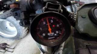 6. Arctic cat 700 diesel with after market RPM, oil and water gauge.