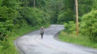 9. 2004 Husqvarna cr 125 wheelie up the road