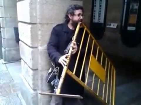 Guy plays metal road barrier like a flute – what a time to be alive!