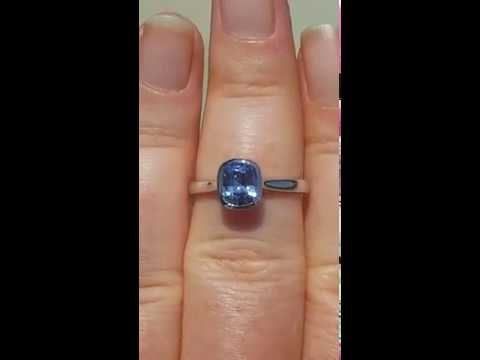Blue Sapphire Engagement Ring with White Gold Bezel