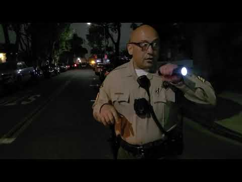 """UNSTABLE sheriff points his firearm  @EastLosAudits saying """"what do you have in your hands"""""""