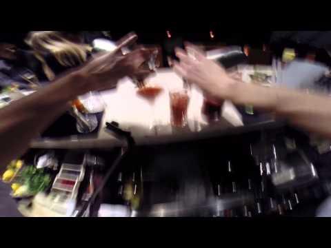 Extremely skilled bartender making drinks