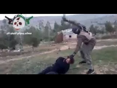 Bloodshed as three men are BEHEADED by Syrian Rebel fighters, CIA allegedly arm Syrian rebels
