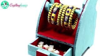 How to make a mini cute jewellery box cum bangle stand (2 in 1) with waste cardboard and paper. Best out of waste material craft idea for girls to manage their jewelry, bangles easily and decorate their room.  For more amazing DIY Craft Ideas, visit http://www.craftinghours.com Connect us on Facebook: https://www.facebook.com/CraftingHours/Follow us on Twitter: https://twitter.com/craftinghours