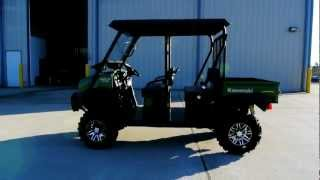 3. 2013 Kawasaki Mule 4010 Trans Diesel With Top, Windshield, Lift, Stereo, and Tires