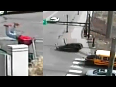 Driver Barrels Through Intersection Before Jumping Over Fence in Police Pursuit