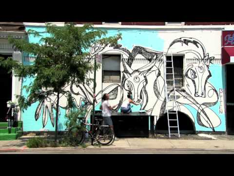 erinnthomasclancy - Street artist BETTEN painting a mural in Manhattan.