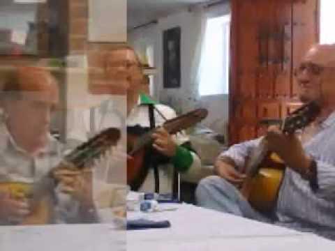 Bandurriator - El trio formado por Rafael Suarez,Miguel Abascal y Julian Nuñez interpreta el pasodoble Amparito Roca . En el video se incorpora la pagina del arreglo realiz...