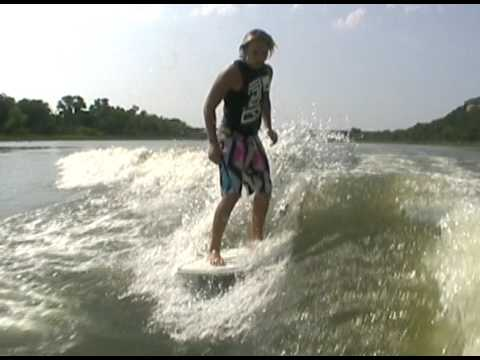 Keenan riding behind a Centurion on Inland Surfer board