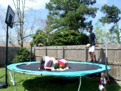 Boy dunks ball and falls