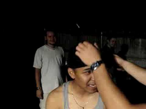 Kid shoots bottle rocket off his head FUNNY!