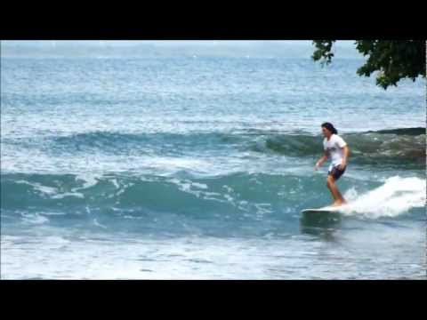 husni - Indonesian longboarder Husni Ridwan surfing his home break in Batukaras, Java.
