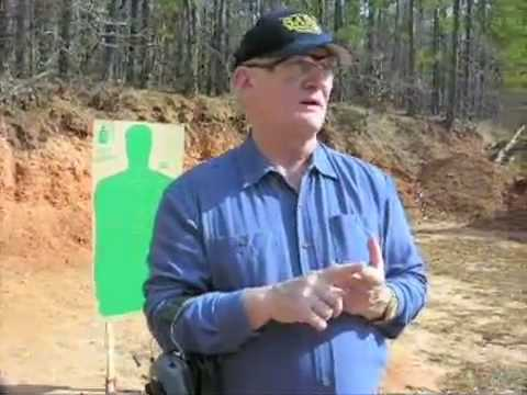 chl - Rol Coggins, Texas Concealed Handgun Course Instructor explains the Texas Course of Fire while Richard Schultz shoots a perfect score of 250 at the Longview ...