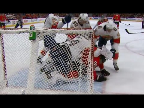 Reimer delivers a few blocker shots in fight as tempers flare between Panthers and Blackhawks