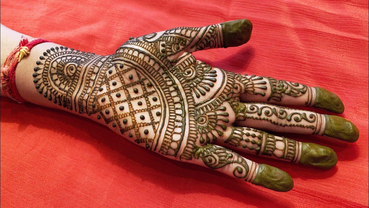 beautiful rajasthani half hand mehndi design