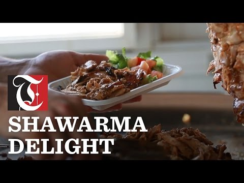 Shawarma is a seasoned meat marinated in a blend of herbs and spices hand-layered and roasted on a cone-shaped vertical rotisserie spit.