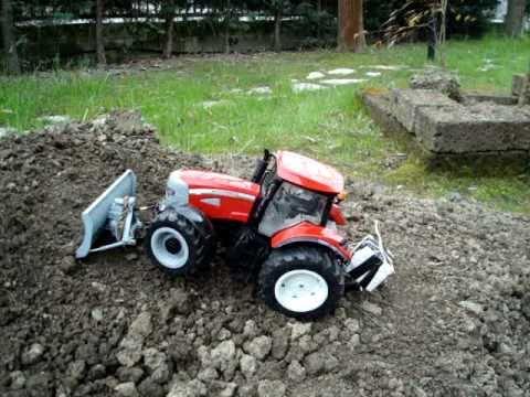 TRATTORE TRAKTOR traktoren TRACTOR BRUDER RC TEST  RUSPA TERRA Schneeräumschild snow blade plow.MPG
