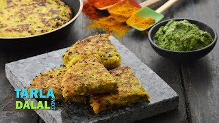 Mixed Vegetable Handvo,Recipe Link : https://www.tarladalal.com/Mixed-Vegetable-Handvo-Non-Fried-Snacks-33316rSubscribe : http://goo.gl/omhUioTarla Dalal App: http://www.tarladalal.com/free-recipe-app.aspxFacebook: http://www.facebook.com/pages/TarlaDalal/207464147348YouTube Channel: http://www.youtube.com/user/TarlaDalalsKitchen/featuredPinterest: http://www.pinterest.com/tarladalal/Google Plus:  https://plus.google.com/107883620848727803776Twitter: https://twitter.com/Tarla_DalalMixed Vegetable HandvoMixed Vegetable Handvo is a delicious snack made with readymade idli batter reinforced with loads of tasty, juicy, crunchy veggies! A tempering of mustard and sesame seeds adds to the flavour and aroma of this tasty treat. We have cooked the handvo in a tava and cut it into handy-sized pieces for easy serving. This yummy snack is neither too complex nor does it require deep-frying, yet it is irresistibly tasty and sure to be loved by all! It is easy to make, and can be made without any advance planning as it requires no soaking or fermentation. Serve it with green chutney for a satiating tea-time snack! Preparation Time: 15 minutes.Cooking Time: 25 minutes.Serves 3.  For the handvo batter2 cups readymade idli batter¼ cup grated bottle gourd (doodhi / lauki)¼ cup finely chopped spinach (palak)2 tbsp grated onions2 tbsp grated carrot2 tbsp finely chopped coriander (dhania)1 tsp sugar1 tsp green chilli paste½ tsp garlic (lehsun) paste¼ tsp turmeric powder (haldi)½ tsp chilli powderSalt to tasteOther ingredients6 tsp oil1½ tsp mustard seeds (rai / sarson)1½ tsp sesame seeds (til)3 pinches of asafoetida (hing)For servingGreen chutneyFor the handvo batterCombine all the ingredients along with approx. 2 tbsp of water in a deep bowl and mix well. Keep aside.How to proceed1. Divide the handvo batter into 3 equal portions and keep aside.2. Heat 2 tsp of oil in a small non-stick pan, add ½ tsp of mustard seeds, ½ tsp of sesame seeds and a pinch of asafoetida and sauté on a mediu